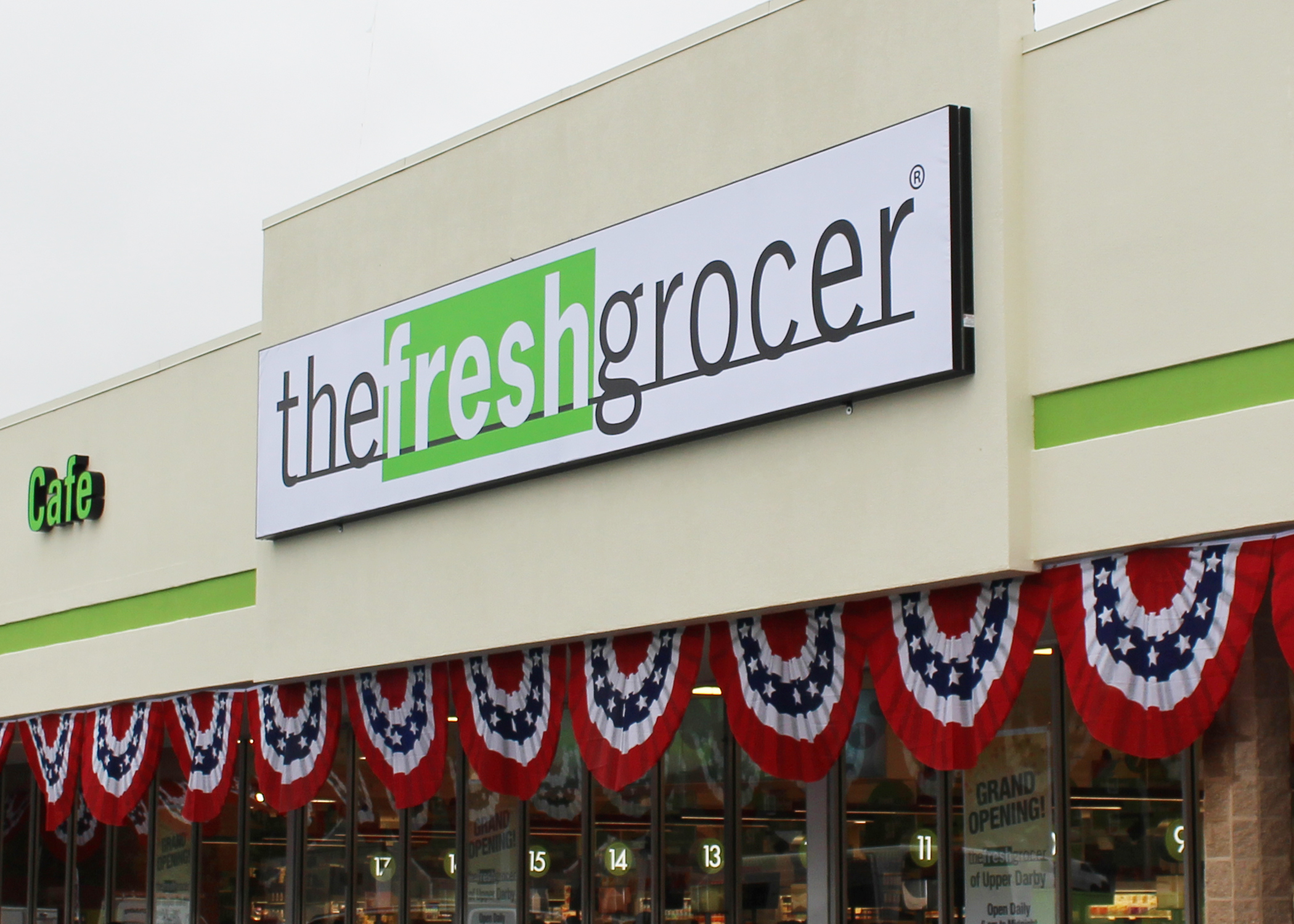 The Fresh Grocer building with large sign.